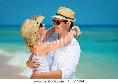 Loving Couple On A Clean Blue Sea
