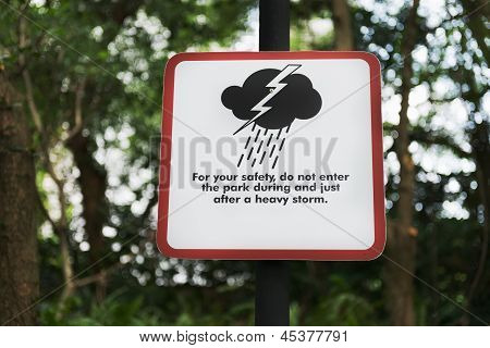 Storm warning sign in a modern park poster