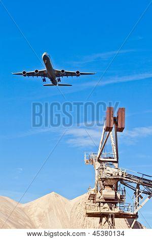 aircraft in landing approach under blue sky poster