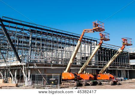 Construction Crane At Building Site