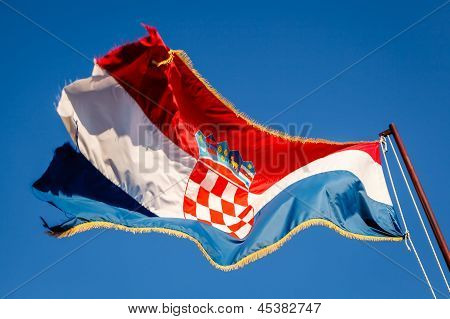 Croatian Flag Waving on a Pole over Beautiful Blue Sky in Omis Croatia poster