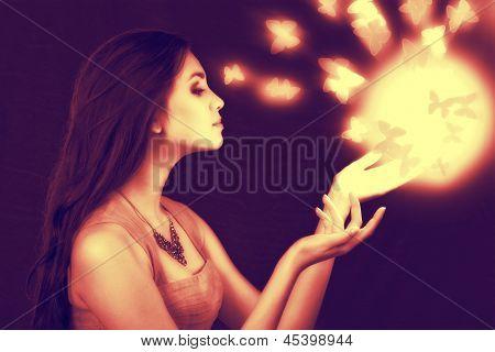 lighting sphere in hands. attractive fairy girl poster