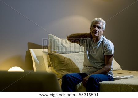 Senior man awake in the bed