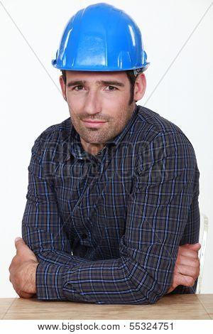 Portrait of an uneasy tradesman