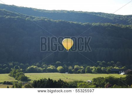 Hot air balloon flying over Dordogne in southwestern France