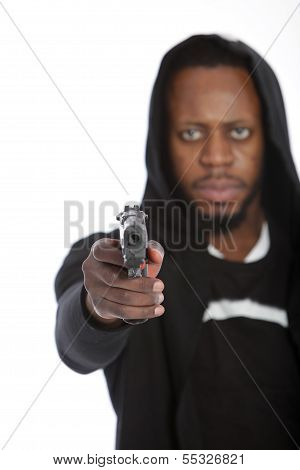 African Thug Aiming A Gun At The Camera