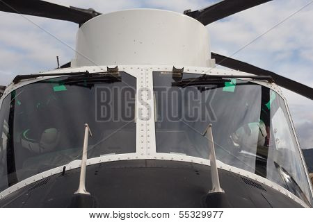 Cockpit of helicopter static on the ground poster