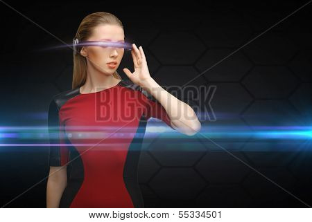 business and future technology concept - beautiful woman with futuristic glasses