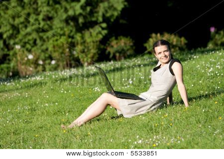 Girl With A Laptop In Park