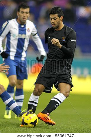 BARCELONA - NOV, 30: Carlos Vela of Real Sociedad during a Spanish League match against RCD Espanyol at the Estadi Cornella on November 30, 2013 in Barcelona, Spain