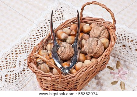 handpiece for cracking nuts and peanuts in basket on a table poster