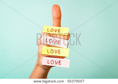 Hand with love message on blue background
