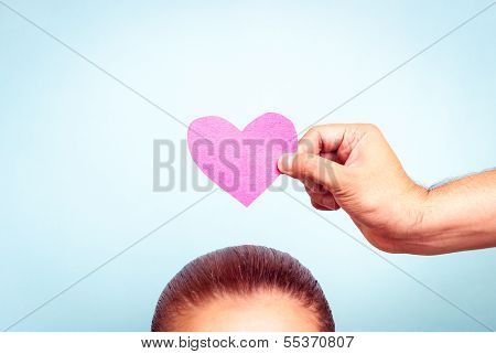 Pink love heart woman on blue background