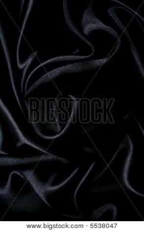 Slät Elegant svart silke som bakgrund