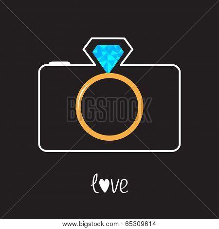 Photo camera and gold wedding ring lens. Diamond flash. Love car