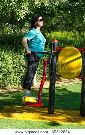 Woman Working Out On A Air Swinger Machine Station Outdoor