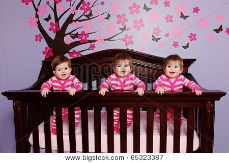 Sweet Baby Triplets in Crib
