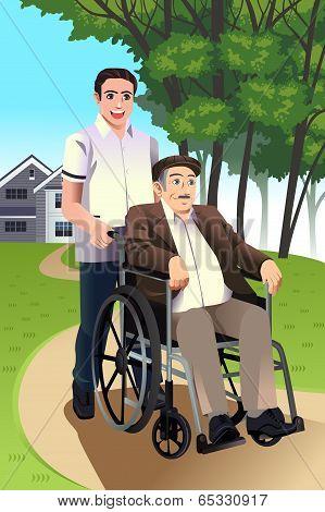 Man Pushing A Senior Man In A Wheelchair