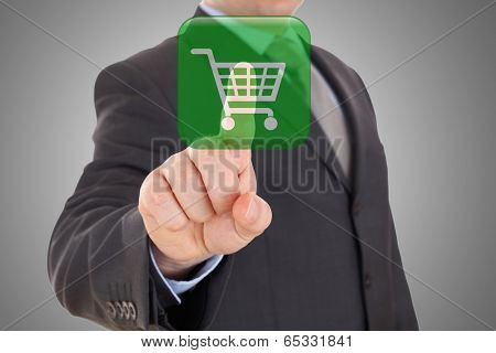 Hand pushing virtual symbol of online shopping