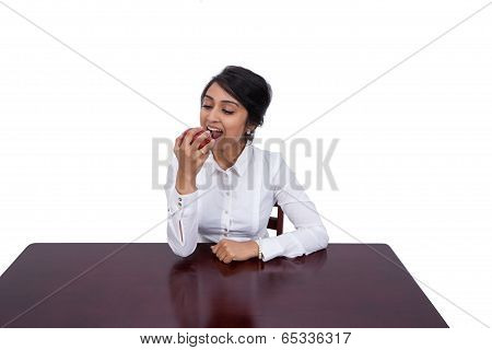 Businesswoman eating an apple
