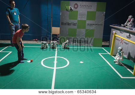 Kid Playing Soccer With Nao Robot At Wired Next Fest In Milan, Italy