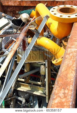 Yellow Gas Pipe In A Landfill Of Waste