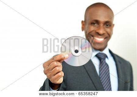 Handsome Businessman Holding A Cd