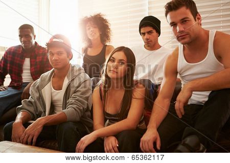 Portrait Of Gang Members Sitting On Sofa In House poster