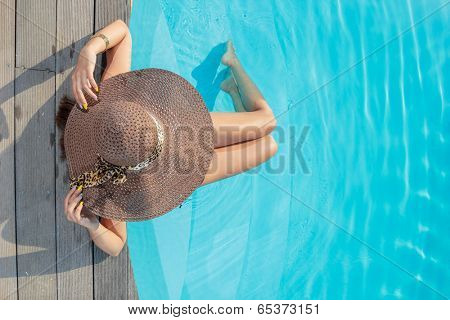 Top view of a  girl in the swimming pool