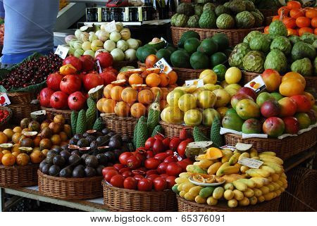 FUNCHAL, PORTUGAL - April 30, 2014: Unknown people visiting the vegetable market of the famous Merca