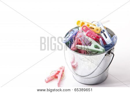 Colorful Clothespins That Were Placed In A Bucket Of Tin