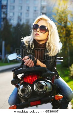 The blonde in points on motorcycle