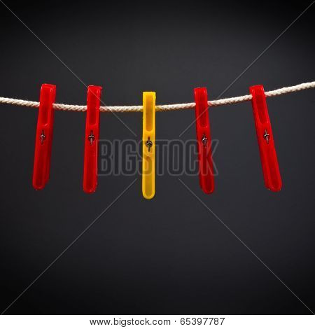 Clothes Pin Standing Out From The Crowd