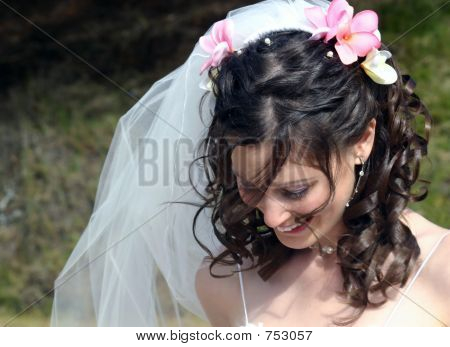 Bride with Frangipanis in Hair