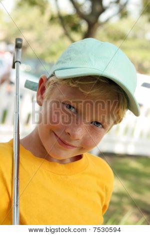 Boy Plays Golf In Blue Cap