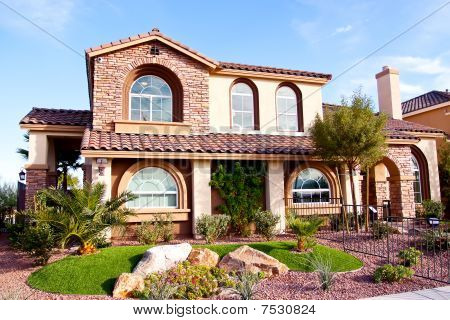 Exterior view of a southwestern stucco house poster