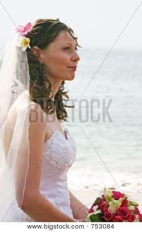 Bride on Beach with Bouquet