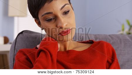 Sad African Woman Sitting On Couch