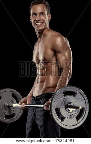 Muscular bodybuilder guy doing exercises with big dumbbell over black background poster