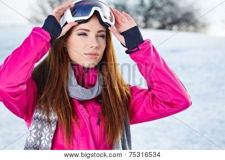 Portrait of woman in winter scenery