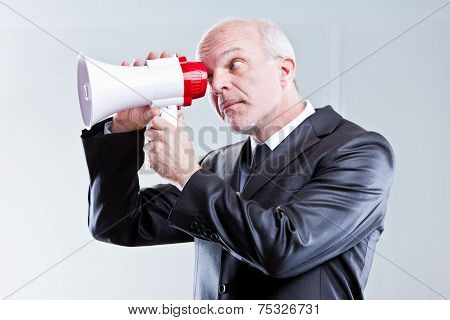 Man Using A Megaphone With Eyes Instead Of Mouth