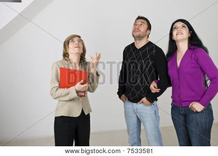 Young Couple Meeting With Estate Agent