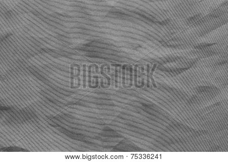 the abstract textured background from crumpled mesh with small cells synthetic fabric of gray color poster