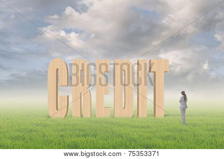 Concept of credit, reliance, promise etc with 3d text under sky on the outdoor grassland and one Asian business woman thinking about it.