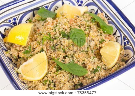 Turkish bulgur wheat salad, known as kisr, made with mint, cucumber,  lemon, romato and parsley, seen from a high angle poster