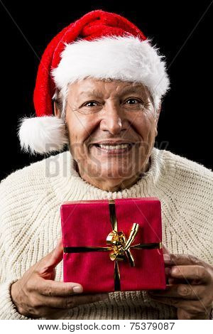 Aged Man With Santa Claus Cap And Red Xmas Gift