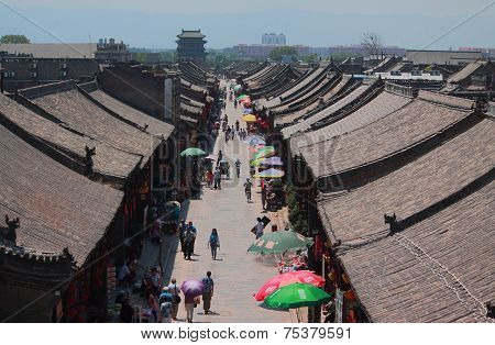 people are walking on the pedestrian street in Pingyao