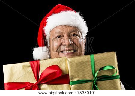 Smiling Aged Man Peeking Across Two Golden Gifts