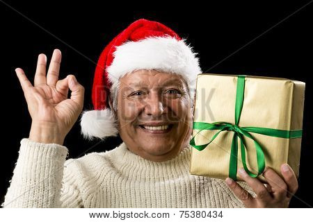 Grinning Male Senior With Gift Gesturing Ok Sign