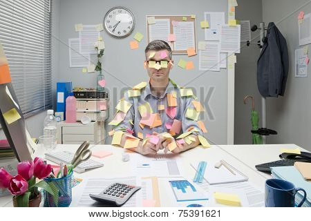 Office Worker Covered With Stick Notes
